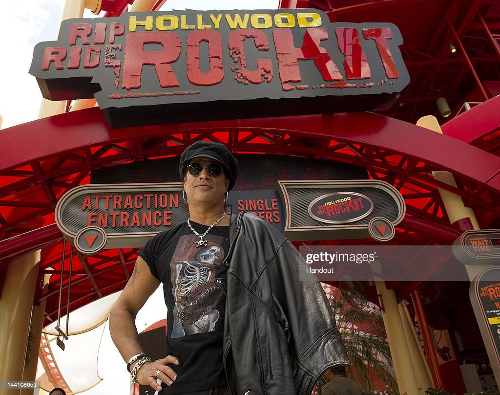 In this handout image provided by Universal Oralndo Resort, legendary rocker and former lead guitarist of Guns N' Roses, Slash, was hosted by Universal Orlando Resort on May 8, 2012 in Orlando, Florida. Slash experienced 'Hollywood Rip Ride Rockit' a roller coaster that allows guests to choose the soundtrack for their ride. During his ride, he rocked out to ZZ Top's 'Gimme All Your Lovin'. Best known for guitar solos in timeless hits like 'November Rain' and 'Sweet Child O Mine,' Slash enjoyed both Universal Orlando theme parks after a live performance at Hard Rock Live during his North American tour with Myles Kennedy and The Conspirators.