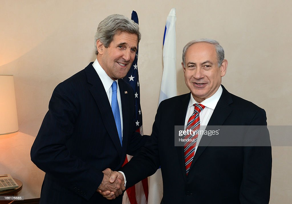 In this handout image provided by U.S. Embassy Tel Aviv, Israel's Prime minister <a gi-track='captionPersonalityLinkClicked' href=/galleries/search?phrase=Benjamin+Netanyahu&family=editorial&specificpeople=118594 ng-click='$event.stopPropagation()'>Benjamin Netanyahu</a> shakes hands with U.S. Secretary of State <a gi-track='captionPersonalityLinkClicked' href=/galleries/search?phrase=John+Kerry&family=editorial&specificpeople=154885 ng-click='$event.stopPropagation()'>John Kerry</a> on April 09, 2013 in Jerusalem, Israel. Secretary Kerry is in the region to meet with Israeli and Palestinian officials in an attempt to help restart the peace process.