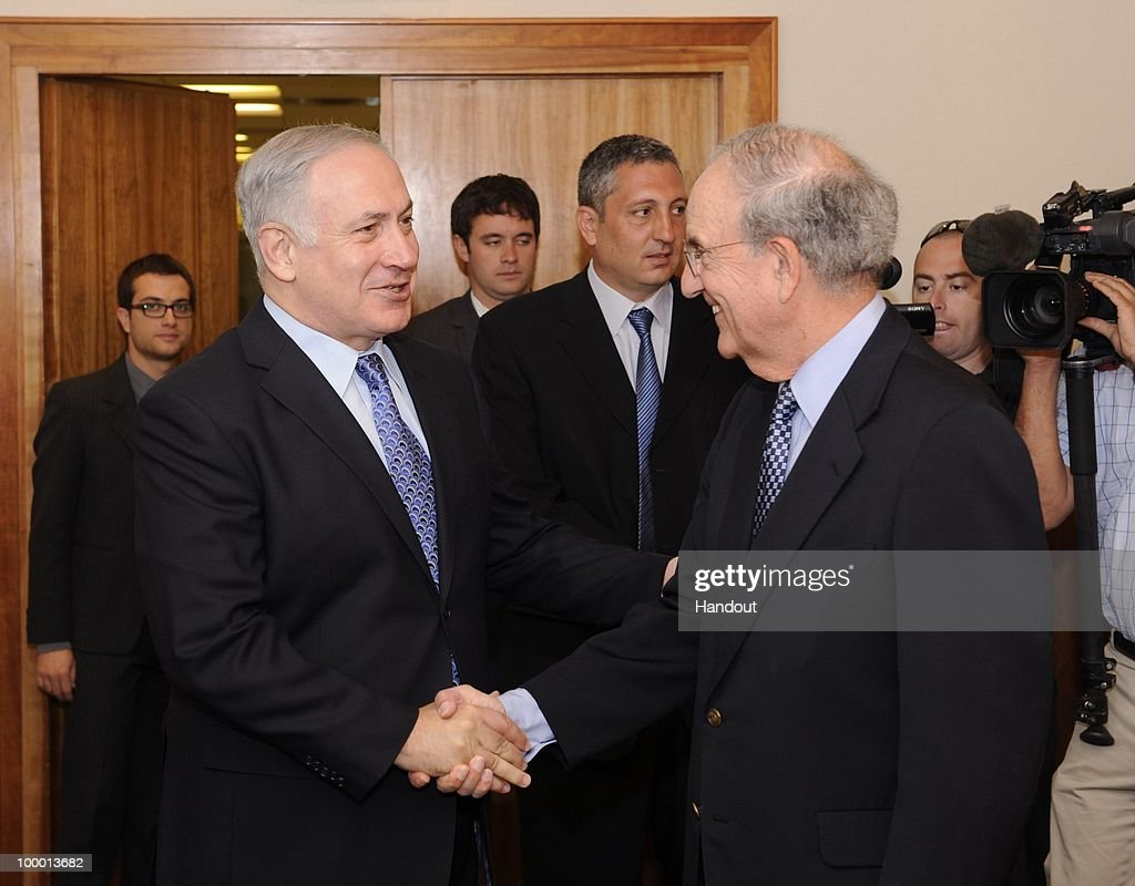 In this handout image provided by U.S. Embassy Tel Aviv, US Special Envoy George Mitchell (R) shakes hands with Israeli Prime Minister Binyamin Netanyahu as they meet at the Prime Minister's office on May 20, 2010 in Tel Aviv, Israel. Special envoy Mitchell has initiated a new round of middle east talks, mediating between the Israelis and Palestinian National Authority, while both parties refuse to hold direct talks.
