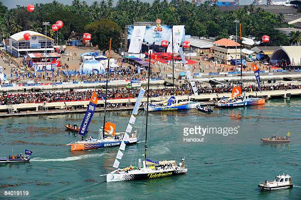 In this handout image provided by Volvo Ocean Race watched by crowds on the dockside the fleet of Volvo Open 70s make their way to the start line for...
