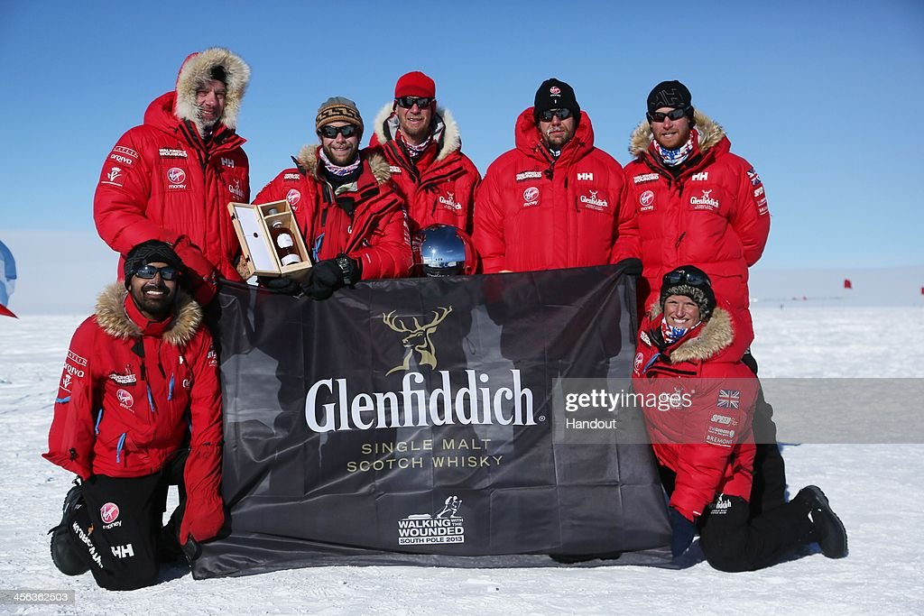 In this handout image provided by Walking with the Wounded, (L-R) Ibrar Ali, Conrad Dickenson, Guy Disney, Richard Ire, Duncan Slater, Prince Harry and Kate Philp of Team UK as they reach the South Pole as part of their Walking With The Wounded charity trek on December 13, 2013 in Antartica. The Virgin Money South Pole Allied Challenge 2013, of which Prince Harry is patron, will see the participants race across three degrees to the South Pole. All 12 injured service personnel from Britain, America, Canada and Australia have overcome life-changing injuries and undertaken challenging training programmes to prepare themselves for the conditions they will face in Antarctica. Trekking around 15km to 20km per day, the teams endured temperatures as low as minus 45C and 50mph winds as they pulled their 70kg sleds to the south pole.