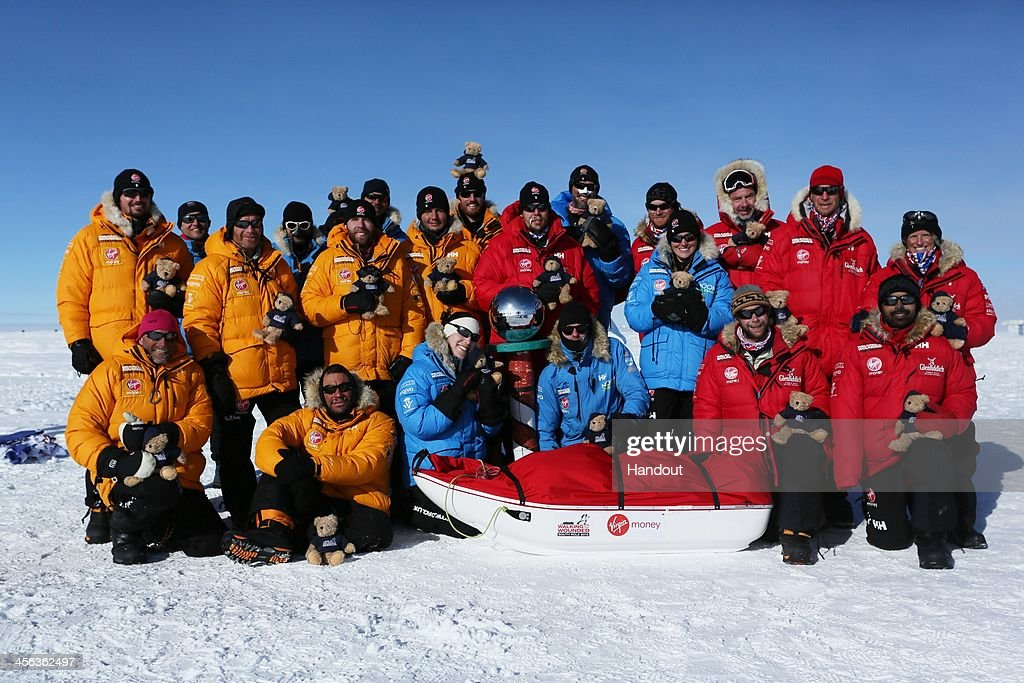 In this handout image provided by Walking with the Wounded, Prince Harry (back row 4th R) poses with members of Team UK, Team Commonwealth and Team US as they reach the South Pole as part of their Walking With The Wounded charity trek on December 13, 2013 in Antartica. The Virgin Money South Pole Allied Challenge 2013, of which Prince Harry is patron, will see the participants race across three degrees to the South Pole. All 12 injured service personnel from Britain, America, Canada and Australia have overcome life-changing injuries and undertaken challenging training programmes to prepare themselves for the conditions they will face in Antarctica. Trekking around 15km to 20km per day, the teams endured temperatures as low as minus 45C and 50mph winds as they pulled their 70kg sleds to the south pole.