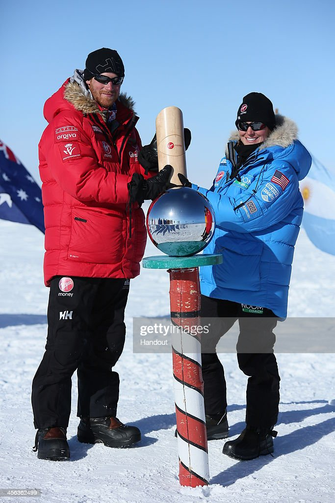 In this handout image provided by Walking with the Wounded, Prince Harry (L) and Margaux Mange of Team US as they and their fellow adventurers reach the South Pole as part of their Walking With The Wounded charity trek on December 13, 2013 in Antartica. The Virgin Money South Pole Allied Challenge 2013, of which Prince Harry is patron, will see the participants race across three degrees to the South Pole. All 12 injured service personnel from Britain, America, Canada and Australia have overcome life-changing injuries and undertaken challenging training programmes to prepare themselves for the conditions they will face in Antarctica. Trekking around 15km to 20km per day, the teams endured temperatures as low as minus 45C and 50mph winds as they pulled their 70kg sleds to the south pole.