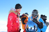 In this handout image provided by Walking with the Wounded Prince Harry and Ivan Castro touch the pole as they and their fellow adventurers reach the...