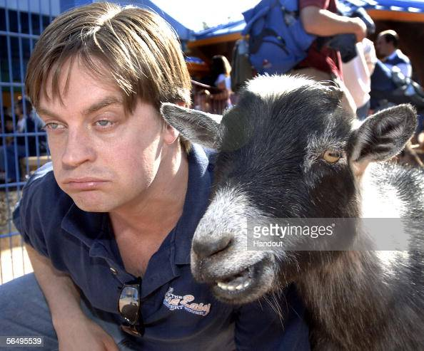 In this handout image provided by Walt Disney World reminiscent of his 'Goatboy' skit on 'Saturday Night Live' comedian Jim Breuer meets a real goat...