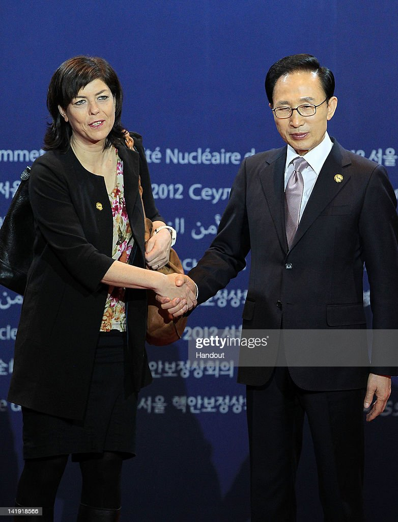 In this handout image provided by Yonhap News, Belgian Deputy Prime Minister Joelle Milquet and South Korean President Lee Myung-bak pose at the welcoming ceremony for the Nuclear Security Summit at COEX on March 26, 2012 in Seoul, South Korea. World leaders gather at Seoul to discuss on the issues to prevent possible nuclear terrorism and recurrence of meltdown of nuclear power plants and to minimize nuclear material across the world.