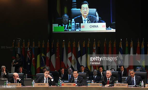 In this handout image provided by Yonhap News Chinese President Hu Jintao speaks during the 2012 Seoul Nuclear Security Summit at COEX on March 27...