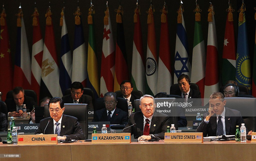 In this handout image provided by Yonhap News Chinese President Hu Jintao Kazakh President Nursultan Nazarbayev and US President Barack Obama attend...