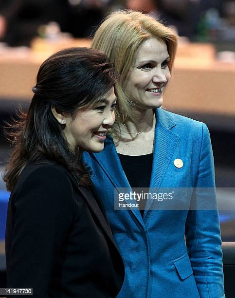 In this handout image provided by Yonhap News Thai Prime Minister Yingluck Shinawatra and Danish Prime Minister Helle ThorningSchmidt pose during the...