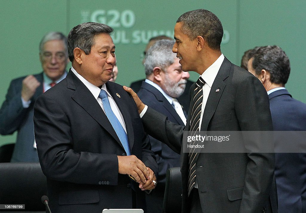 In this handout image provided by Yonhap News, U.S. President <a gi-track='captionPersonalityLinkClicked' href=/galleries/search?phrase=Barack+Obama&family=editorial&specificpeople=203260 ng-click='$event.stopPropagation()'>Barack Obama</a> (R) speaks with Indonesian President <a gi-track='captionPersonalityLinkClicked' href=/galleries/search?phrase=Susilo+Bambang+Yudhoyono&family=editorial&specificpeople=206513 ng-click='$event.stopPropagation()'>Susilo Bambang Yudhoyono</a> at the opening plenary session during day two of the 2010 G20 Summit at COEX on November 12, 2010 in Seoul, South Korea. World leaders converged on Seoul for the fifth meeting of the G20 group of nations to discuss the global financial system and world economy. South Korea is the first non G-8 country to host the G-20 summit.