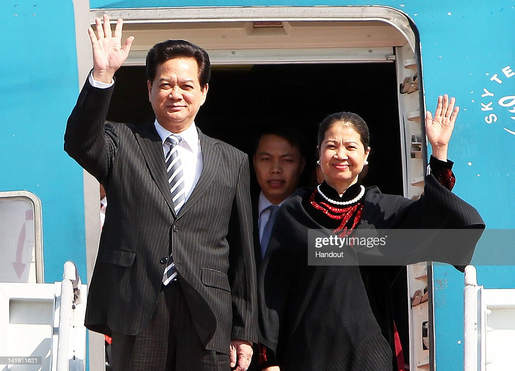 In this handout image provided by Yonhap News, Vietnamese Prime Minister Nguyen Tan Dung and his wife Tran Thanh Kiem arrive at Seoul Airport to attend the 2012 Seoul Nuclear Security Summit on March 26, 2012 in Seongnam, South Korea. World leaders gather at Seoul to discuss on the issues to prevent possible nuclear terrorism and recurrence of meltdown of nuclear power plants and to minimize nuclear material across the world.