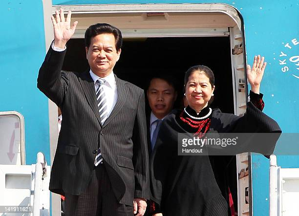 In this handout image provided by Yonhap News Vietnamese Prime Minister Nguyen Tan Dung and his wife Tran Thanh Kiem arrive at Seoul Airport to...