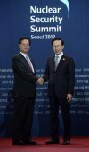 In this handout image provided by Yonhap News Vietnamese Prime Minister Nguyen Tan Dung and South Korean President Lee Myungbak pose at the welcoming...