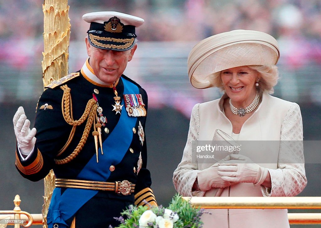In this handout image released by Clarence House, the image used on The Prince of Wales's and The Duchess of Cornwall's Christmas card displays <a gi-track='captionPersonalityLinkClicked' href=/galleries/search?phrase=Prince+Charles+-+Prince+of+Wales&family=editorial&specificpeople=160180 ng-click='$event.stopPropagation()'>Prince Charles</a>, Prince of Wales and <a gi-track='captionPersonalityLinkClicked' href=/galleries/search?phrase=Camilla+-+Duchess+of+Cornwall&family=editorial&specificpeople=158157 ng-click='$event.stopPropagation()'>Camilla</a>, Duchess of Cornwall (R) as they take part in The Thames River Pageant, as part of the Diamond Jubilee, marking the 60th anniversary of the accession of Queen Elizabeth II on June 3, 2012 in London, England. Clarence House are asking that publications which use the photograph consider making a modest donation to The Prince of Wales's Charitable Foundation - donations should be made payable to The Prince of Wales's Charitable Foundation and be sent to Amanda Foster at The Prince of Wales and The Duchess of Cornwall's Press Office, Clarence House, London SW1A 1BA. The photograph was taken by Danny Martindale. Please credit Danny Martindale, Wireimage if you use this image.