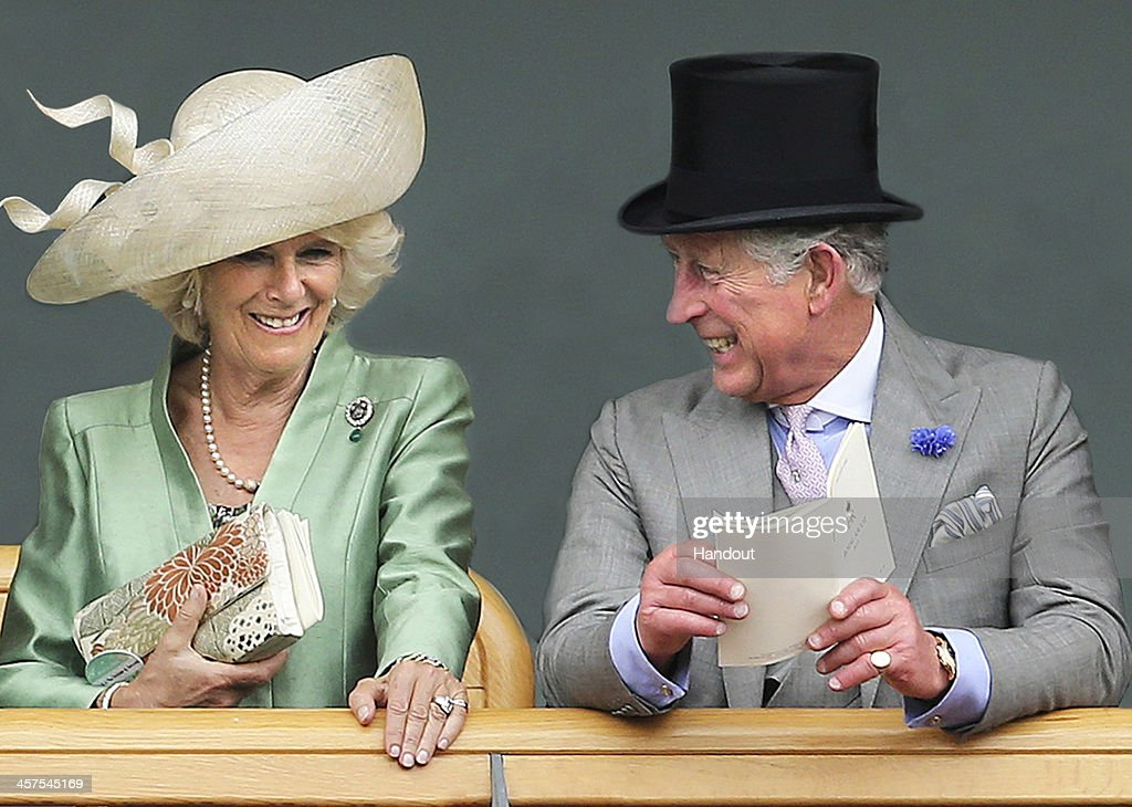 In this handout image released by Clarence House, the image used on The Prince of Wales's and The Duchess of Cornwall's Christmas card displays <a gi-track='captionPersonalityLinkClicked' href=/galleries/search?phrase=Camilla+-+Duchess+of+Cornwall&family=editorial&specificpeople=158157 ng-click='$event.stopPropagation()'>Camilla</a>, Duchess of Cornwall and <a gi-track='captionPersonalityLinkClicked' href=/galleries/search?phrase=Prince+Charles&family=editorial&specificpeople=160180 ng-click='$event.stopPropagation()'>Prince Charles</a>, Prince of Wales as they are seen viewing horses in the parade ring from the Royal Box on the second day of Royal Ascot on June 19, 2013 in London, England. Clarence House are asking that publications which use the photograph consider making a modest donation to The Prince of Wales's Charitable Foundation - donations should be made payable to The Prince of Wales's Charitable Foundation and be sent to Amanda Foster at The Prince of Wales and The Duchess of Cornwall's Press Office, Clarence House, London SW1A 1BA. The photograph was taken by taken by Stephen Lock. Please credit taken by Stephen Lock / i-Images if you use this image.