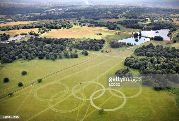 In this handout image released by LOCOG on July 9 an aerial view of Olympic Rings cut into the grass of Richmond Park London England The rings which...
