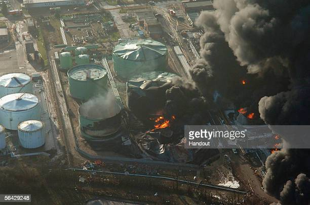 In this handout image released by the Hertfordshire Police Force the devastation caused by the Buncefield oil depot explosion and resulting inferno...