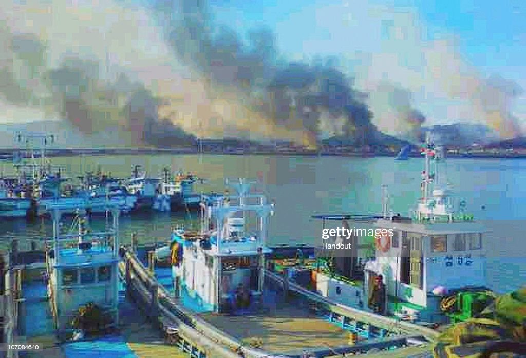 In this handout image smoke rises from South Korea's Yeonpyeong island near the border against North Korea on November 23 2010 in Seoul South Korea...