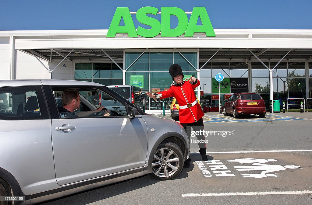 In this handout image supplied by Asda Llangefni on July 11, 2013, a man dressed as a member of the queen's guard poses beside a parking space reserved for a prospective prince or princess, as the Duke and Duchess of Cambridge prepare for the birth of their first child. The supermarket, on the island of Anglesey is situated near to the home that the Duke and Duchess of Cambridge share.