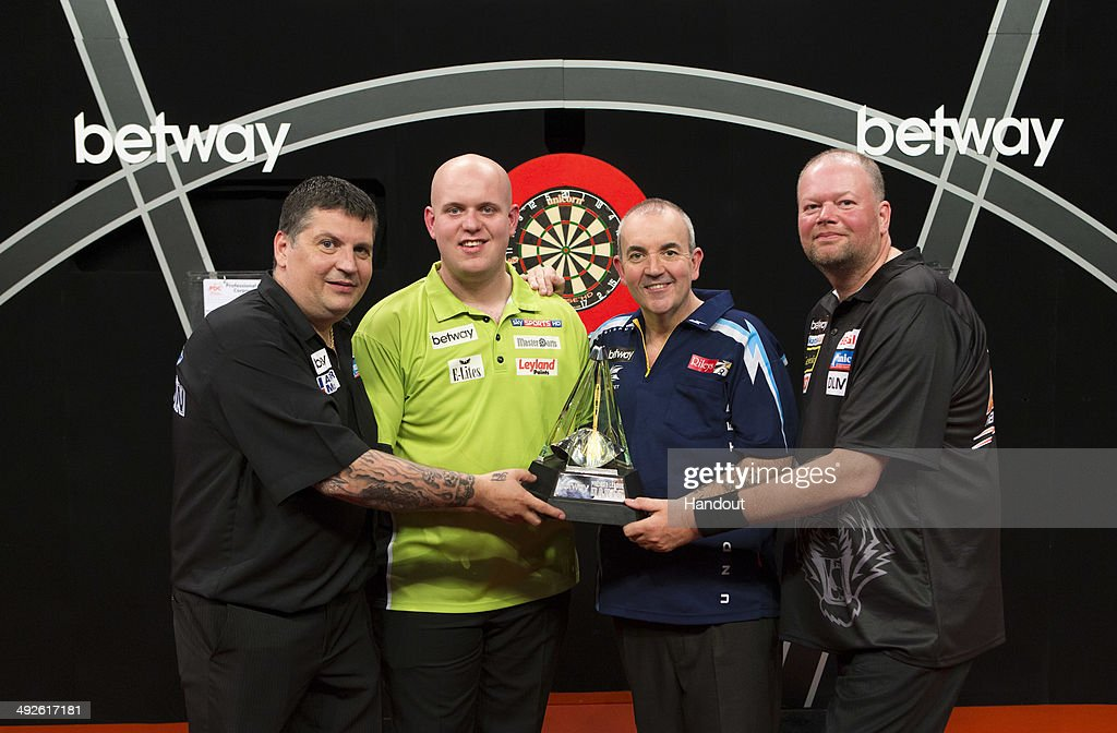 In this handout image supplied by Betway, Gary Anderson, <a gi-track='captionPersonalityLinkClicked' href=/galleries/search?phrase=Michael+van+Gerwen&family=editorial&specificpeople=4754172 ng-click='$event.stopPropagation()'>Michael van Gerwen</a>, Phil Taylor and Raymond van Barneveld pose during a photo call ahead of the Betway Premier League Darts Play-offs on Thursday at London's 02 Arena, on May 13, 2014 in London, England.