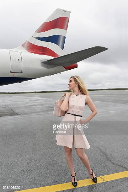 In this handout image supplied by British Airways Birgitte Hjort Sorensen poses on the runway to mark the innuagural flight of a new British Airways...