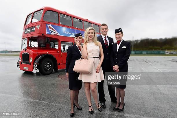 In this handout image supplied by British Airways Birgitte Hjort Sorensen poses with British Airways ambassadors on a red London doubledecker bus on...
