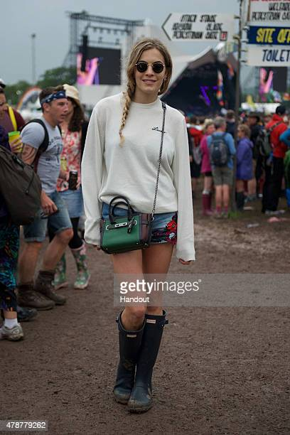 In this handout image supplied by Coach Chelsea Leyland wearing Coach attends the Glastonbury Festival at Worthy Farm Pilton on June 26 2015 in...