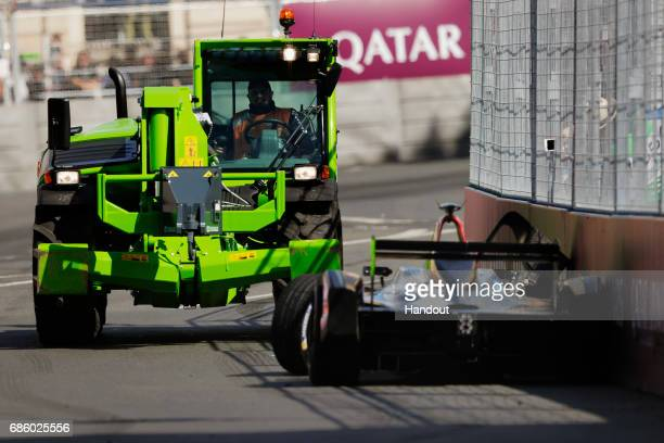 In this handout image supplied by Formula E A recovery vehicle removes the car of JeanEric Vergne Techeetah SparkRenault Renault ZE 16 during the FIA...