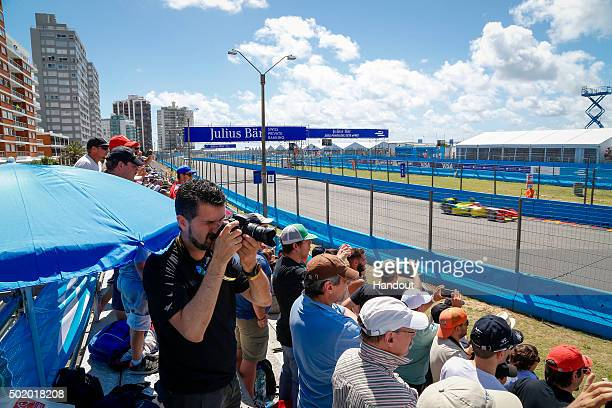 In this handout image supplied by Formula E fans watch the race from the grandstands during the Julius Baer Punta del Este Formula E race at Playa...