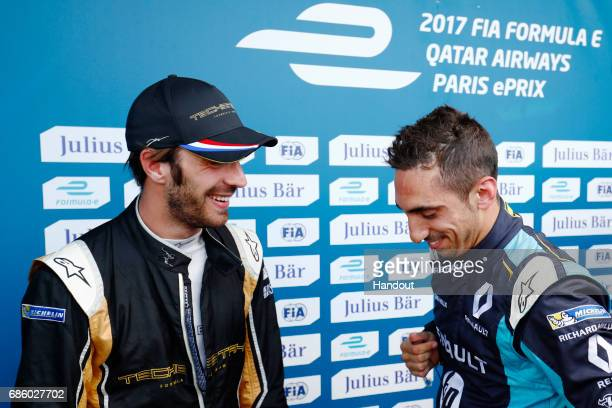 In this handout image supplied by Formula E JeanEric Vergne Techeetah SparkRenault Renault ZE 16 talks with Sebastien Buemi Renault eDams...