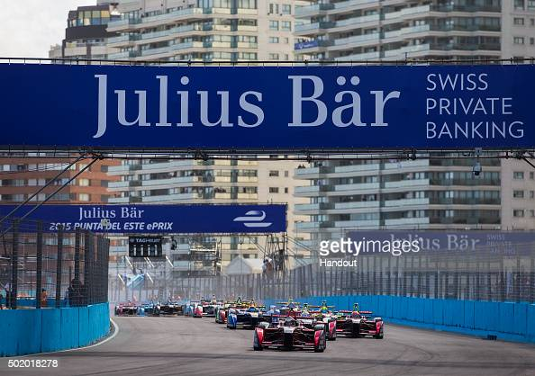 In this handout image supplied by Formula E Jerome D'Ambrosio Dragon Racing Venturi VM200FE01 leads Sam Bird DS Virgin Racing DSV01 and the rest of...