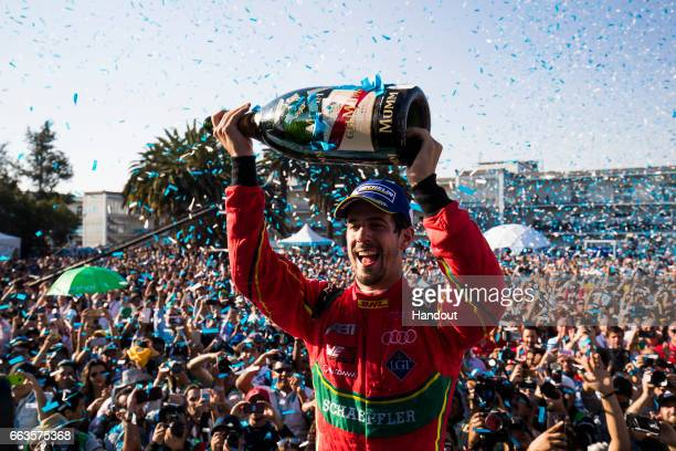 In this handout image supplied by Formula E Lucas Di Grassi ABT Schaeffler Audi Sport SparkAbt Sportsline ABT Schaeffler FE02 celebrates during the...