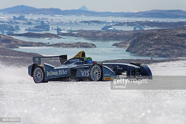 In this handout image supplied by Formula E Lucas di Grassi spins the wheels as he drives the SparkRenault SRT_01E all electric car on the ice cap on...