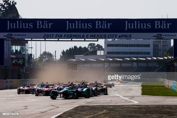 In this handout image supplied by Formula E Oliver Turvey NextEV NIO SparkNEXTEV NEXTEV TCR Formula 002 leads the race at the start during the FIA...