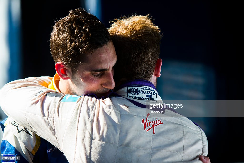 In this handout image supplied by Formula E, Sebastien Buemi (SUI), Renault e.Dams Z.E.15 & Sam Bird (GBR), DS Virgin Racing DSV-01 congratulate each other after the race, during the Buenos Aires Formula E race at Puerto Madero Street Circuit on February 6, 2016 in Buenos Aires, Argentina.
