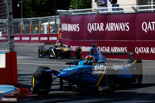 In this handout image supplied by Formula E Sebastien Buemi Renault eDams SparkRenault Renault ZE 16 leadsJeanEric Vergne Techeetah SparkRenault...