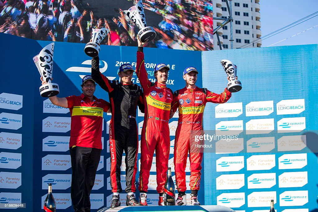 In this handout image supplied by Formula E, <a gi-track='captionPersonalityLinkClicked' href=/galleries/search?phrase=Stephane+Sarrazin&family=editorial&specificpeople=235675 ng-click='$event.stopPropagation()'>Stephane Sarrazin</a> (FRA), Venturi VM200-FE-01, Lucas Di Grassi (BRA), ABT Audi Sport FE01 and Daniel Abt (GER), ABT Audi Sport FE01 on the podium during the Long Beach Formula E race at Long Beach Street Circuit on April 2, 2016 in Long Beach, California.