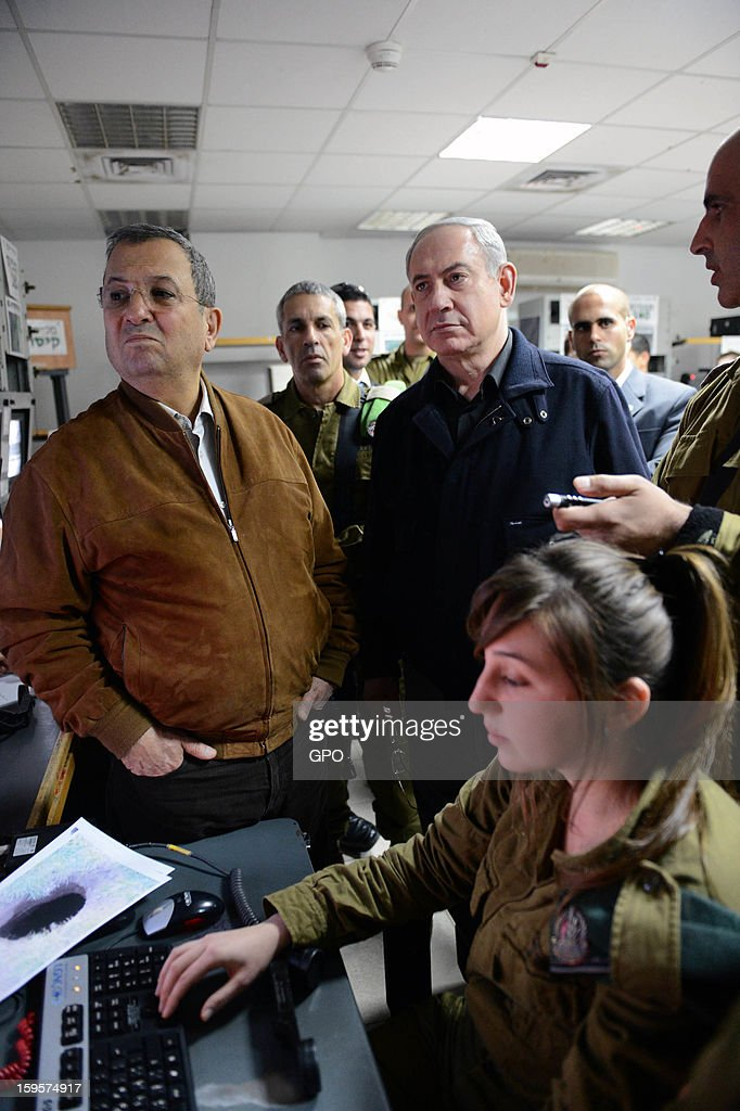 In this handout image supplied by GPO, Israeli Prime Minister <a gi-track='captionPersonalityLinkClicked' href=/galleries/search?phrase=Benjamin+Netanyahu&family=editorial&specificpeople=118594 ng-click='$event.stopPropagation()'>Benjamin Netanyahu</a> and Minister of Defense <a gi-track='captionPersonalityLinkClicked' href=/galleries/search?phrase=Ehud+Barak&family=editorial&specificpeople=202888 ng-click='$event.stopPropagation()'>Ehud Barak</a> visit a base at the Gaza border on January 16, 2013 at an unpecified location, Israel.