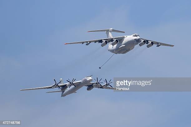 In this handout image supplied by Host photo agency / RIA Novosti An Ilyushin Il78 Midas air force tanker and a Tupolev Tu95MS Bear strategic bomber...