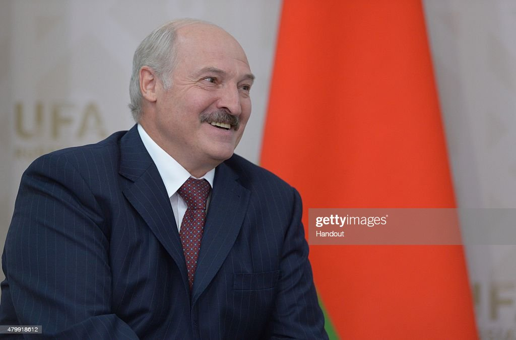 In this handout image supplied by Host Photo Agency / RIA Novosti President of the Republic of Belarus Alexander Lukashenko meets with President of...