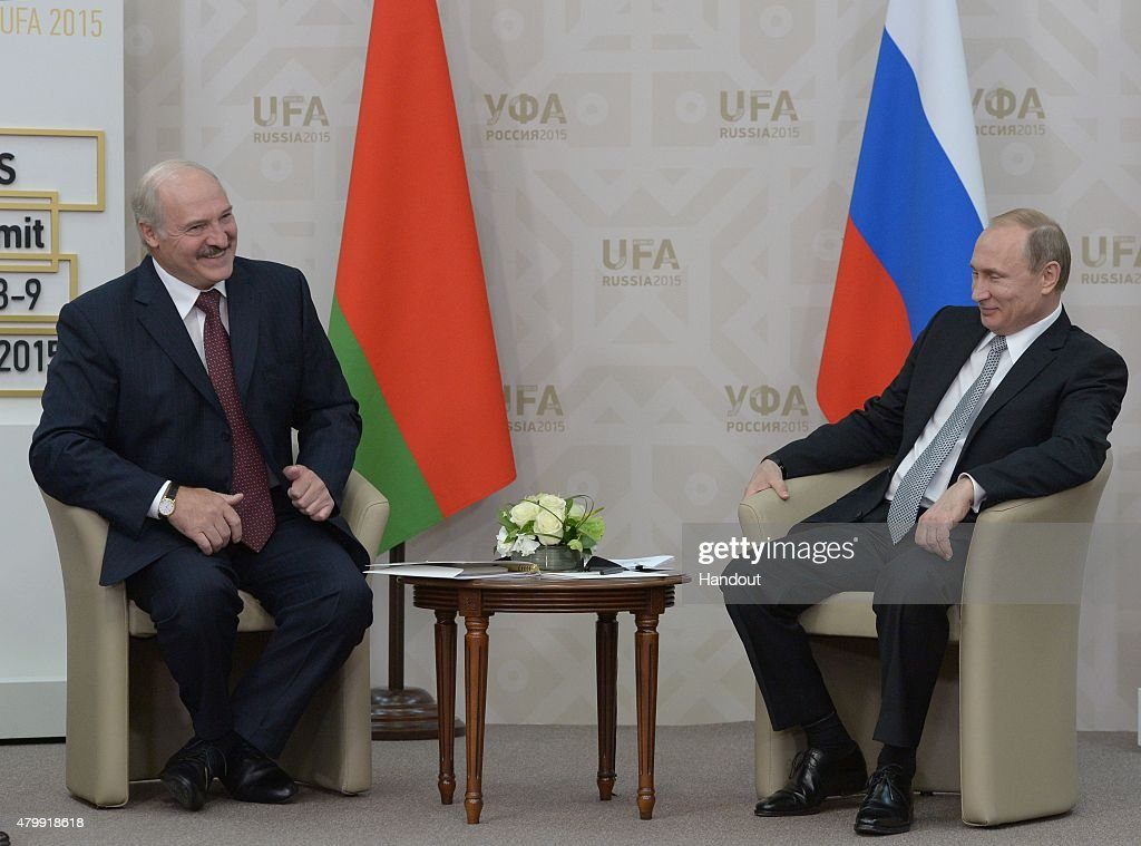In this handout image supplied by Host Photo Agency / RIA Novosti President of the Russian Federation Vladimir Putin meets President of the Republic...