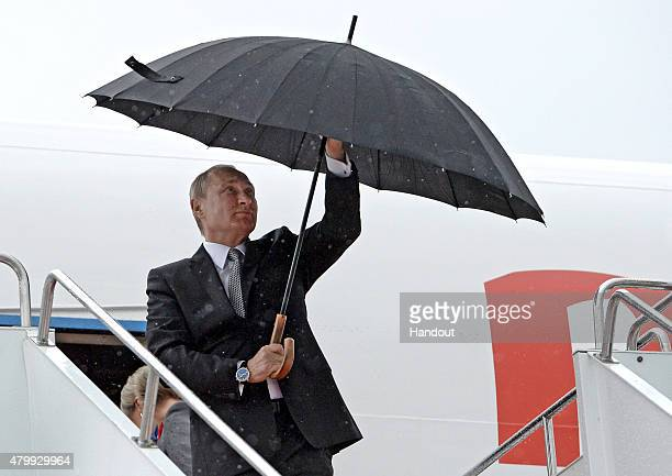 In this handout image supplied by Host Photo Agency / RIA Novosti President of the Russian Federation Vladimir Putin arrives in Ufa for the BRICS/SCO...