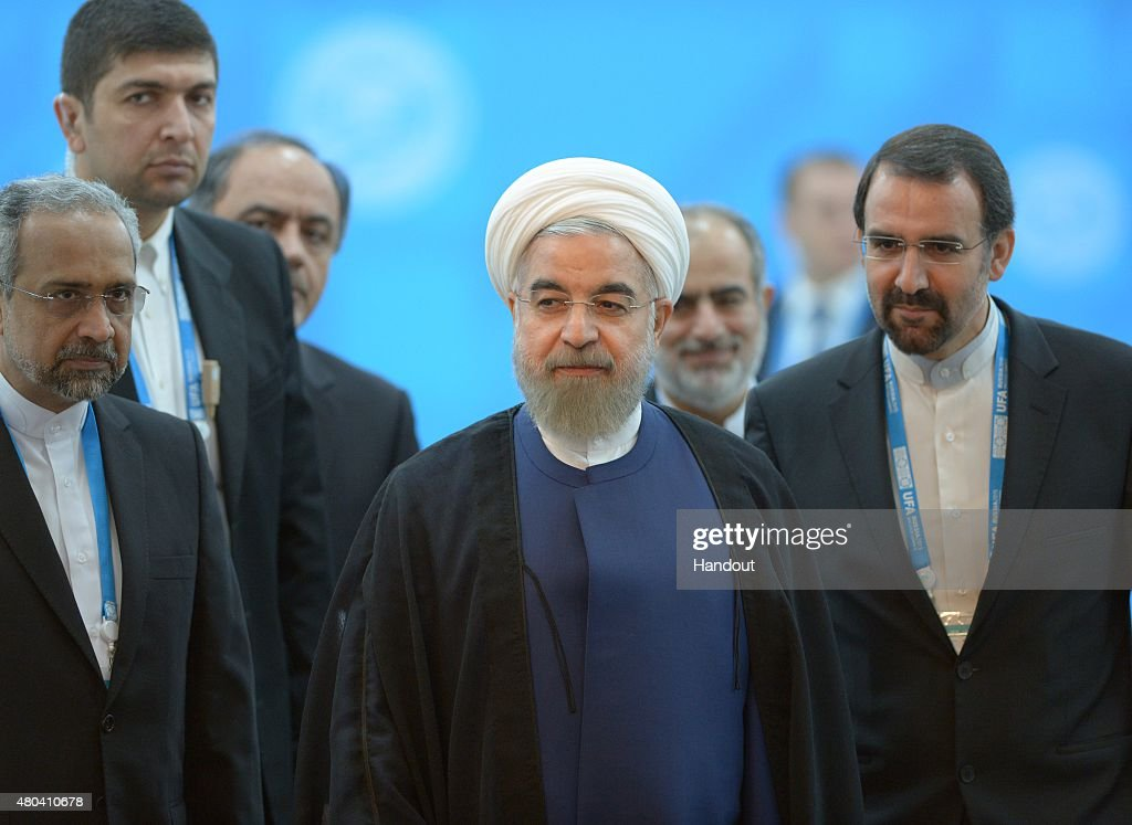 In this handout image supplied by Host Photo Agency / RIA Novosti President of the Islamic Republic of Iran Hassan Rouhani during a meeting with...