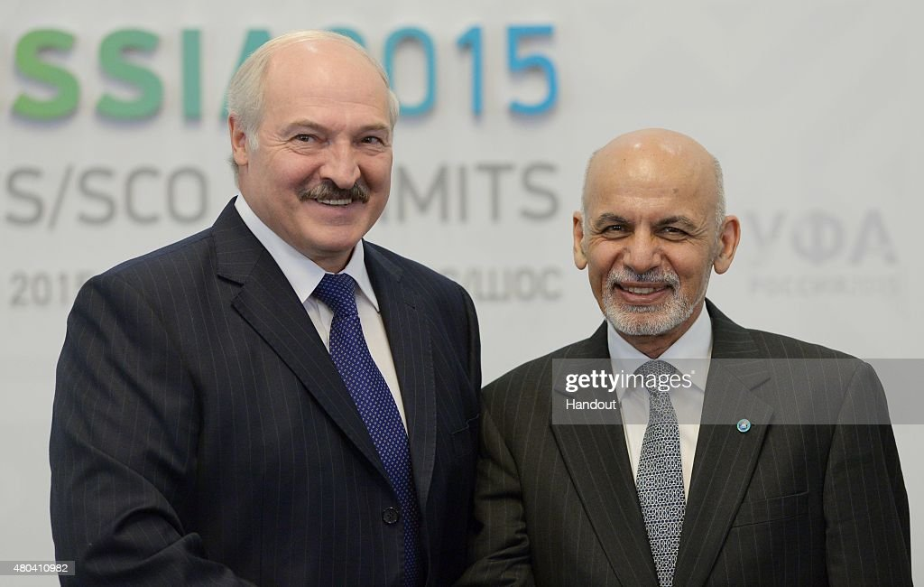 In this handout image supplied by Host Photo Agency / RIA Novosti President of the Republic of Belarus Alexander Lukashenko left and President of the...