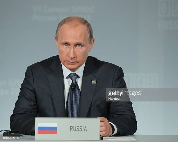 In this handout image supplied by Host Photo Agency / RIA Novosti President of the Russian Federation Vladimir Putin during the signing of joint...