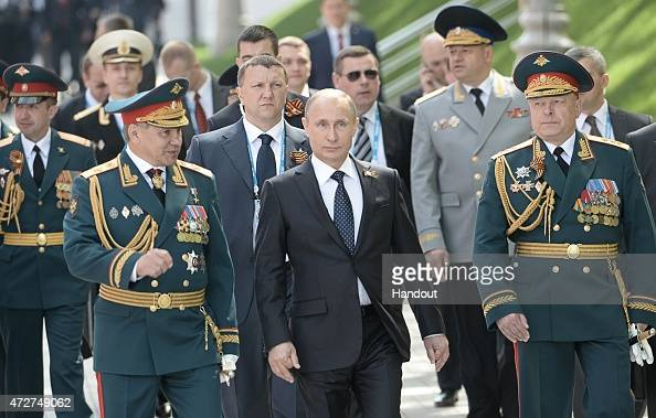 In this handout image supplied by Host photo agency / RIA Novosti Russian President Vladimir Putin center Russian Defense Minister and Army General...