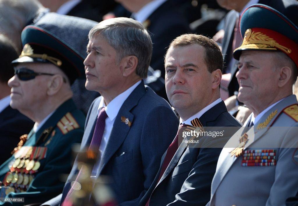 In this handout image supplied by Host photo agency / RIA Novosti, Russian Prime Minister Dmitry Medvedev (second right) and Kyrgyz President Almazbek Atambayev (second left) during the military parade to mark the 70th anniversary of Victory in the 1941-1945 Great Patriotic War, May 9, 2015 in Moscow, Russia. The Victory Day parade commemorates the end of World War II in Europe.