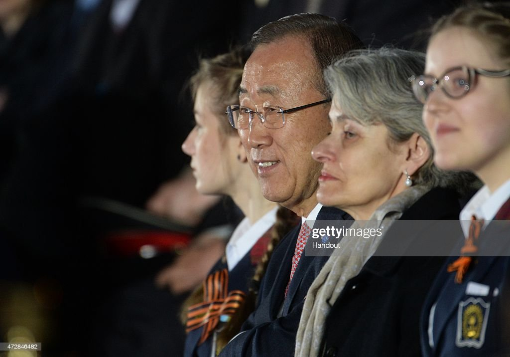 In this handout image supplied by Host photo agency / RIA Novosti, United Nations Secretary-General Ban Ki-moon and UNESCO Director-General <a gi-track='captionPersonalityLinkClicked' href=/galleries/search?phrase=Irina+Bokova&family=editorial&specificpeople=6324408 ng-click='$event.stopPropagation()'>Irina Bokova</a> attend a gala concert held in Red Square to mark the 70th anniversary of Victory in the 1941-1945 Great Patriotic War, May 9, 2015 in Moscow, Russia. The Victory Day parade commemorates the end of World War II in Europe.