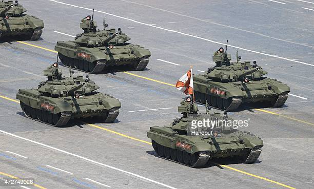 In this handout image supplied by Host photo agency / RIA Novosti T90A main battle tanks during the military parade to mark the 70th anniversary of...