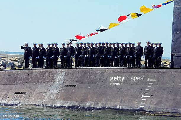 In this handout image supplied by Host photo agency / RIA Novosti The crew of the submarine Magnitogorsk during a rehearsal of the naval parade to...